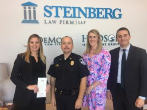 Steinberg Attorney Kelly Alfreds and Catie Meehan with Police Officers